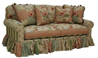 Rosy Hodgepodge Comfy Sofa. Not my style for the living room, but I would love this in a bedroom or casual sitting room.