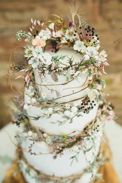 Twigs and lilies make this wedding cake feel woodsy and romantic.