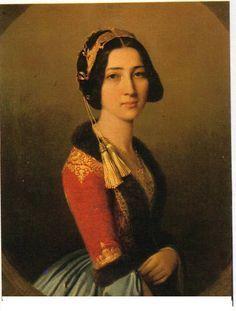 ΦΩΤΕΙΝΉ ΜΑΥΡΟΜΙΧΆΛΗ (1826-1878) ΚΥΡΊΑ ΕΠΊ ΤΩΝ ΤΙΜΏΝ ΤΗΣ ΒΑΣΊΛΙΣΣΑΣ ΑΜΑΛΊΑΣ. Έργο του ζωγράφου της βαυαρικής Αυλής Joseph Karl Stieler (Γιόζεφ Καρλ Στίλερ).