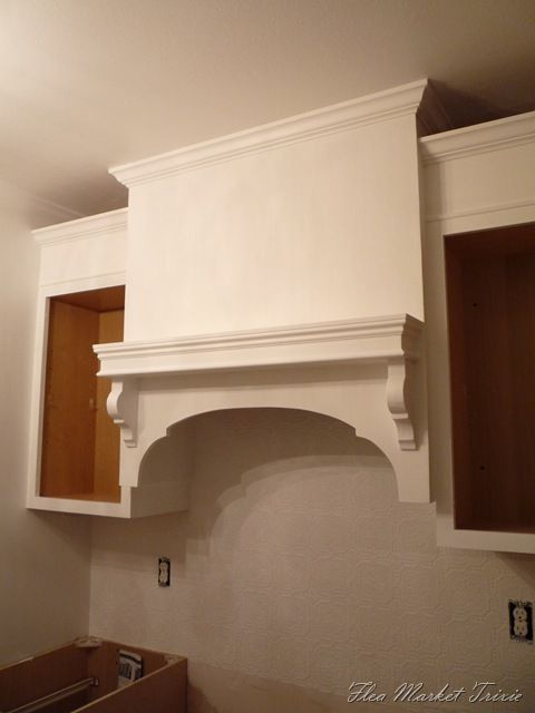 diy kitchen range hood... I would love something like this-- but I would have the cabinets meet the ceiling and have some storage space above the range hood (around the vent pipe). http://www.fleamarkettrixie.com/2010/11/my-custom-built-range-hood.html