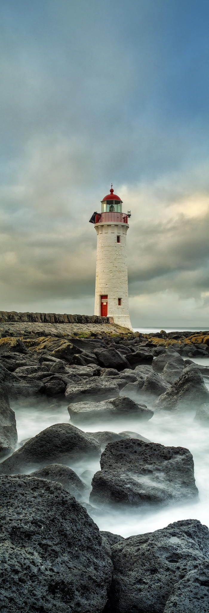 I like this photo because the lighthouse proportioned to the rocks is smaller because it's further in the background