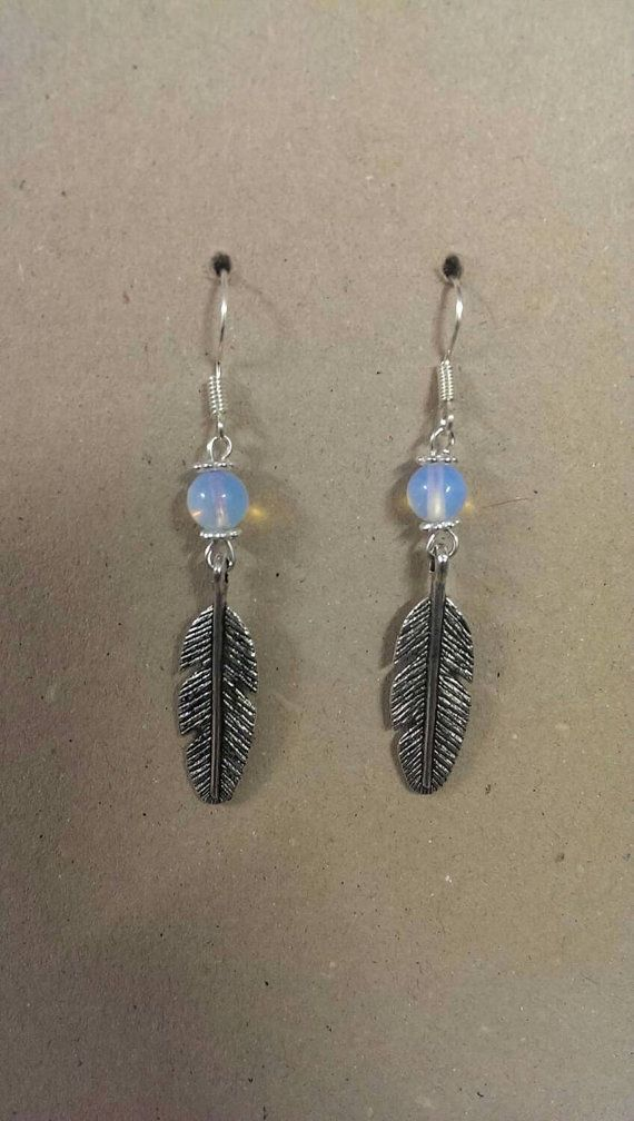 Opal gemstone earrings with feather charm. by KinleysDesigns