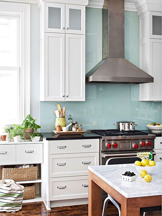 When you want a clean, contemporary look in the kitchen, keep the backsplash treatment simple. A single sheet of glass, painted on the back, lends color and easy-clean protection