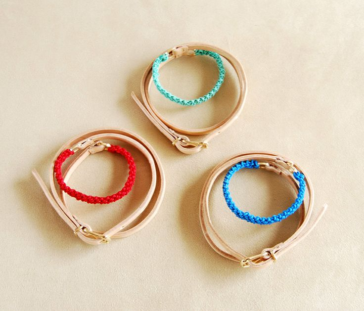 Helena Rohner SS14 - leather wrist wrap with strings in red, aqua and turquoise #helenarohner #bracelet