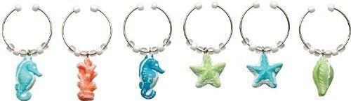 Tropical Ocean Sea Breeze Seahorse Vino Wine Charm S/6 by Boston Warehouse. $9.88. Six piece set. Charms attached to metal rings. Each measures 1/2 inch in length. Boston Warehouse Tropical Ocean Sea Breeze Seahorse Vino Wine Charm S/6