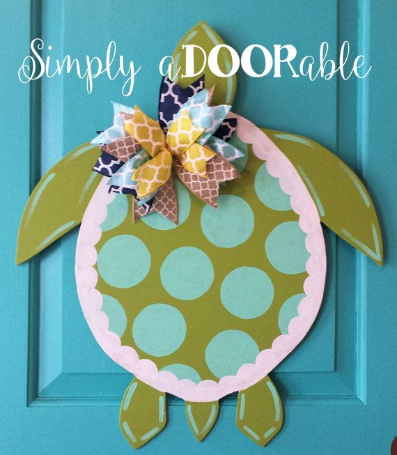 Sea Turtle Wood Door Hanger from Simply aDOORable. This darling Sea Turtle can be customized if you would like different color dots or ribbons.