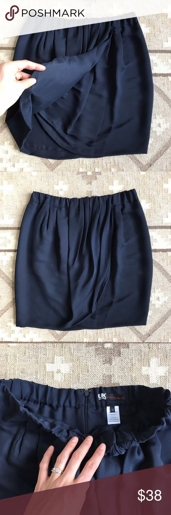 French Connection UK Style Navy Wrap Skirt Elastic banded waist. Tiny pin hole where the layers come together, as it was bobby pinned but is not noticeable unless you search for it. French Connection Skirts Mini