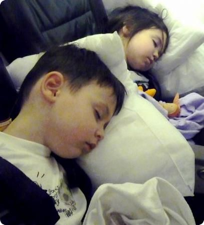 E and D sleeping on the flight home from LA