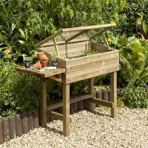 Unlike many other raised planters, this Forest Garden Wooden Trough and Cold Frame Planter allows for year round protection of crops.