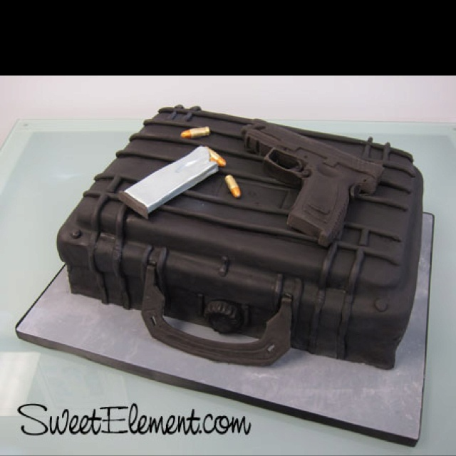 Groom's cake. J & his guns:)