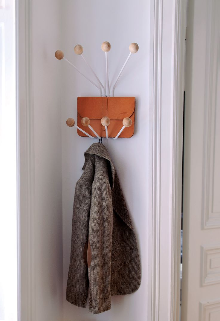 Clothes hanger Bill S from Maze interior. Powder coated wire and knots in birch. Manufactured in Sweden.
