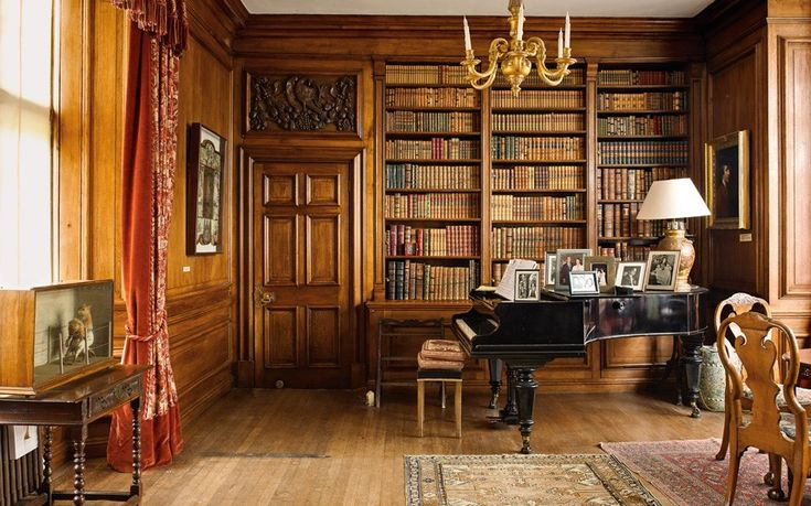 Sudeley Castle- a corner of the Library – family photos are displayed on the Steinway grand piano.
