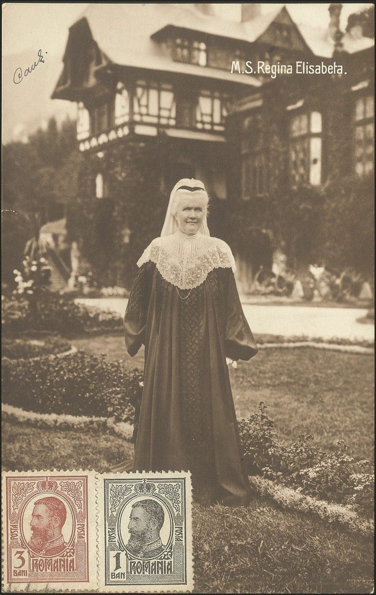 Romania 1912, the widowed Queen Elisabeth in a white mourning veil and a strange robe that looks like a graduation gown.