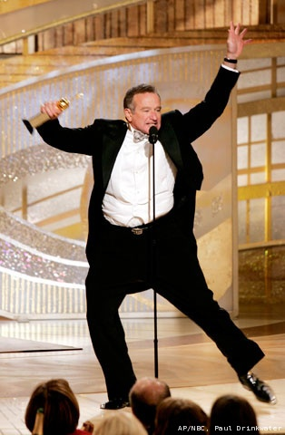 Robin Williams clowns around onstage after accepting the Cecil B. DeMille Award