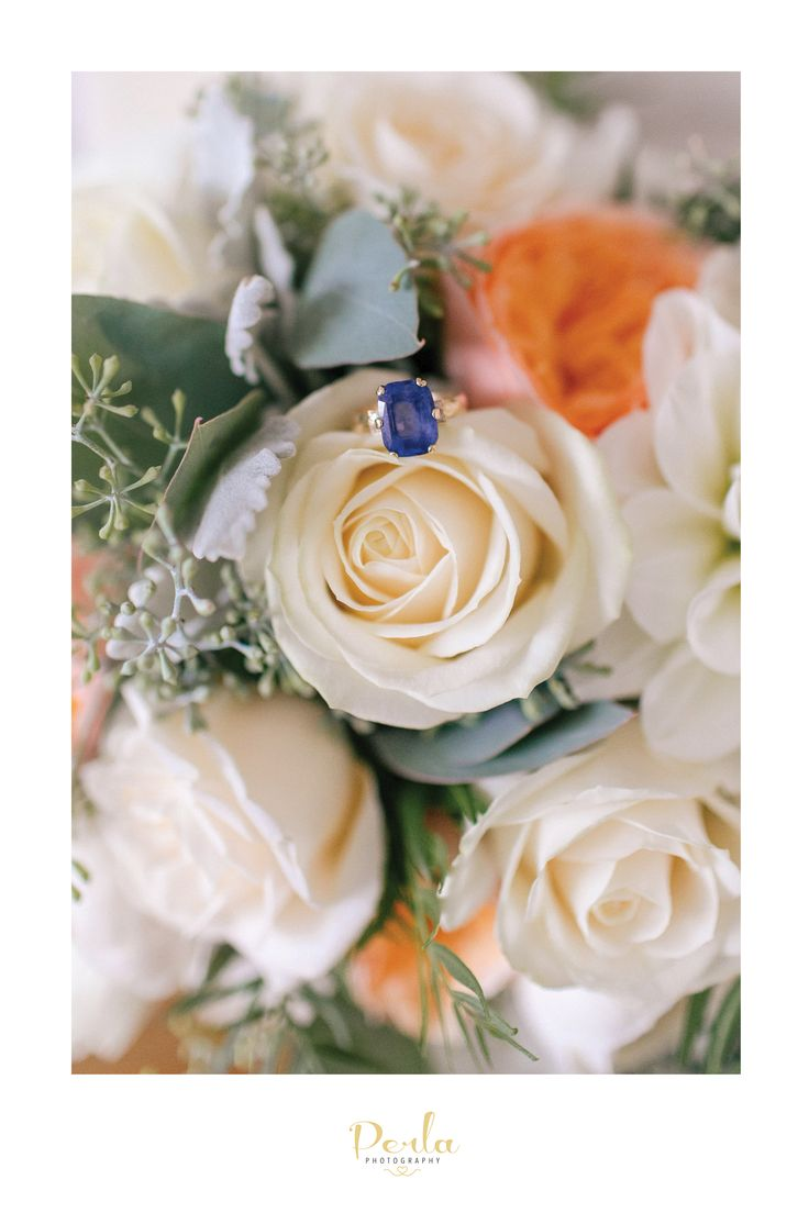 Blue sapphire engagement ring with white roses and dahlias
