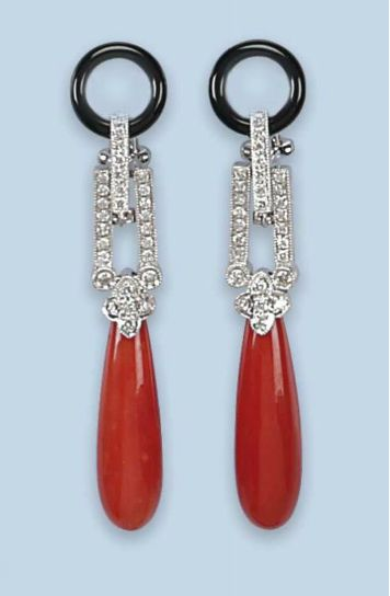A PAIR OF CORAL, ONYX AND DIAMOND EARRINGS   Each onyx loop surmount supporting a diamond-set geometrical connection to the corallium rubrum coral drops