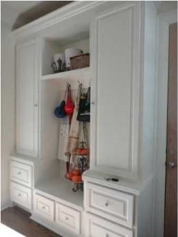 mud room. bring the closet down to the floor and put over head storage on top. create shoe racks enough for the whole family with door to keep shoes hidden.