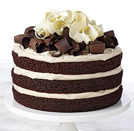 Chocolate Irish Whiskey Cake recipe - This recipe reimagines the classic whiskey-spiked Irish coffee as a decadent mocha layer cake filled with coffee-whiskey whipped cream and topped with white and dark chocolate shavings.