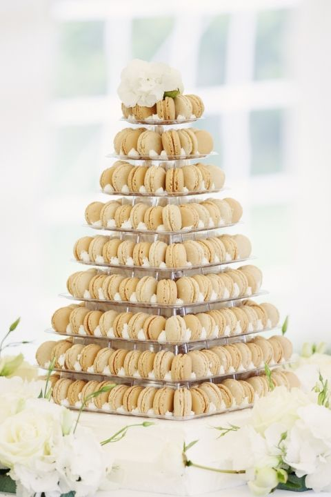 Macaron wedding cake at a French Château wedding. France is a popular wedding destination with beautiful wedding venue, lovely weather, romantic location, and delicious food.