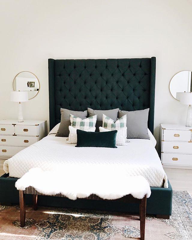 white bedroom + dark emerald headboard