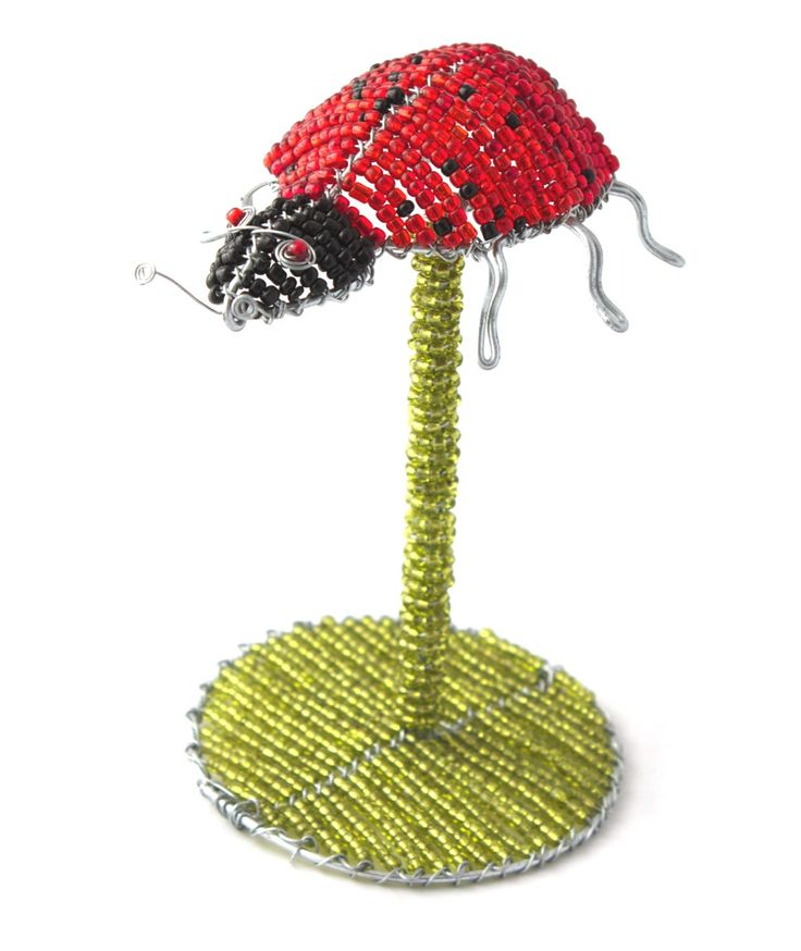 Wire beaded Ladybird on a beaded stand.