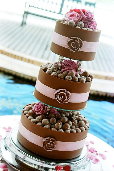 """""""Cake"""" full of Lindt Chocolates! could put some fruit in it instead of candy"""