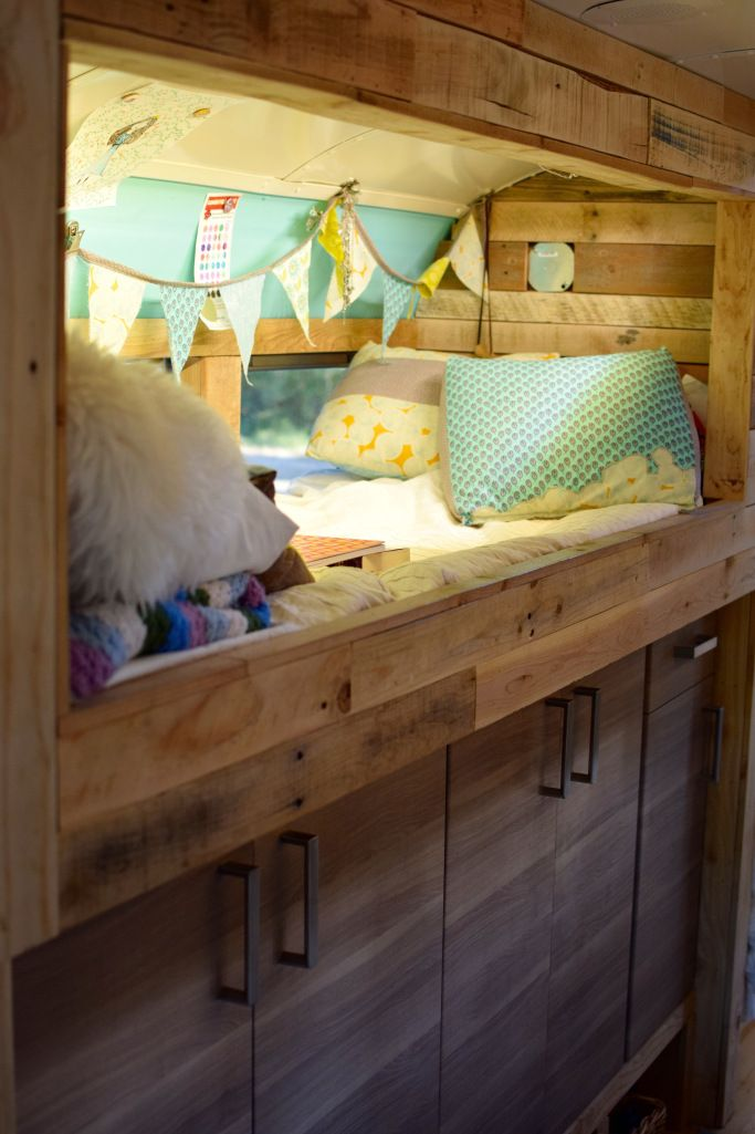 The kids bunks from reclaimed wood are really cute. I like how the kids have personalized them.