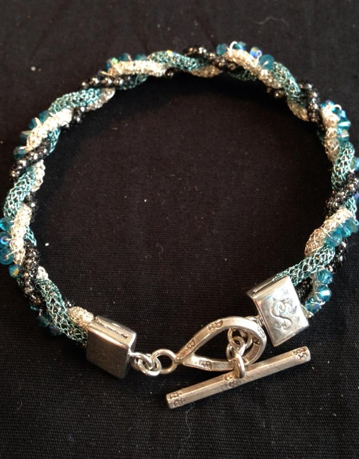 From the Tucson Bead Show via Artbeads...silversilk, Swar crystals.