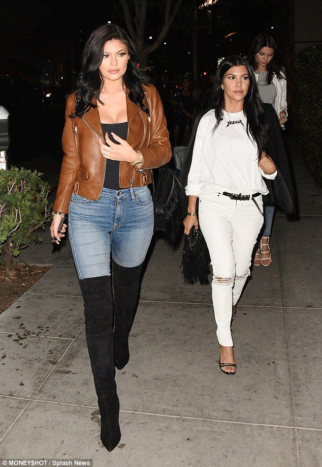 Signature style: Kylie Jenner led the way in a striking yet simple ensemble as she was joined by sisters Kourtney Kardashian and Kendall as they went for dinner in Los Angeles after on Wednesday