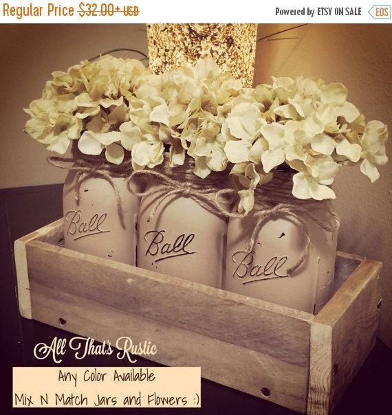 This listing is for our most popular and loved Ball Mason Jar Centerpieces! It is sure to set a perfect rustic look to any home decor! It is very versatile and can be used all year long!! This listing offers you the best quality in wood and jars. Your purchase also includes good quality and full hydrangeas! This listing is custom and the color schemes are unlimited!! You get the chance to mix and match the colors you desire and to what you need and it can also be a bit fun too ;)! These also…