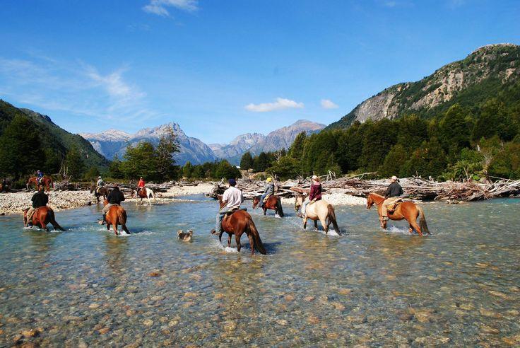 Horse back riding across the Rio Azul with Bio Bio Patagonia
