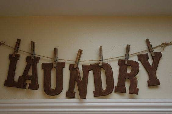 Laundry wooden letters held with clothes pins