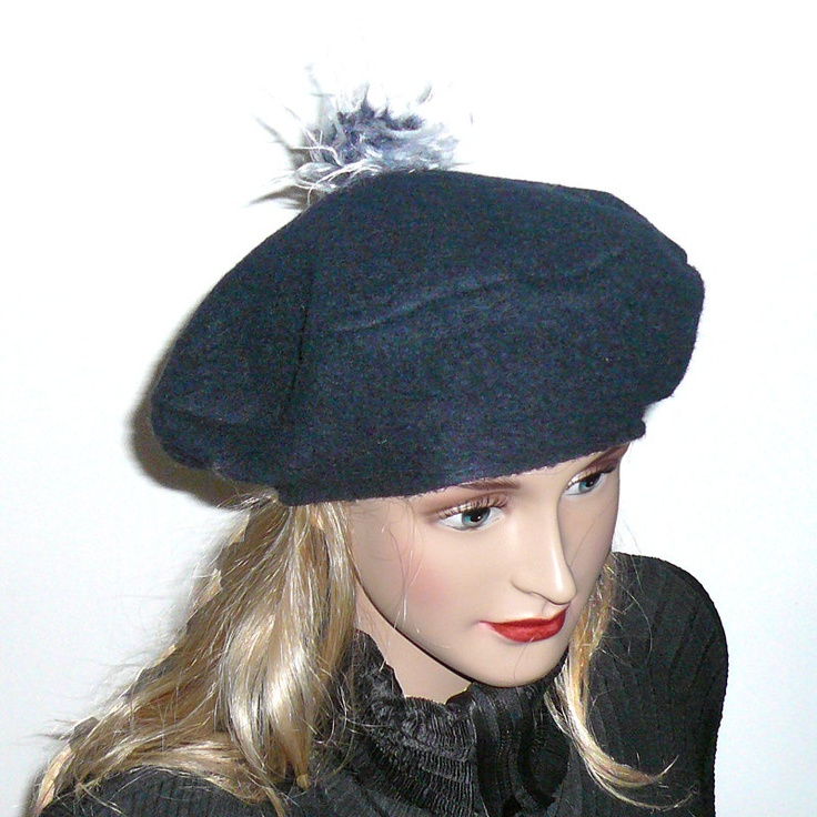 Navy blue fall and winter cap, hat, beret, soft felted wool mixture with funny long hair faux fur pompom. $39.00, via Etsy.