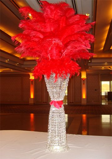 Rent crystal column centerpieces with a red ostrich