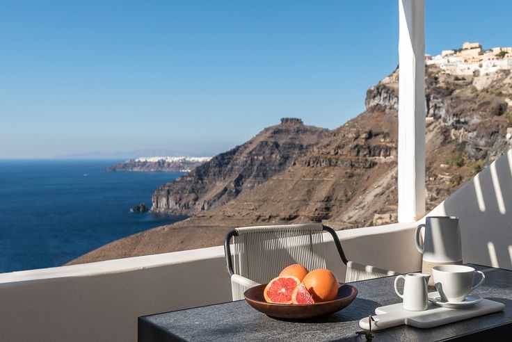 Beautiful views from the terrace - Laboratorium renovate seven suites at Porto Fira luxury hotel in Santorini, Greece. Luxury hotel designs feature on the www.martynwhitedesigns.com interior design blog.