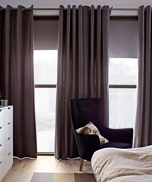 Floor-to-ceiling windows with IKEA curtains and blinds.