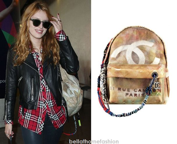 Bella Thorne wears this Graffiti Printed 31 Rue Cameon Paris Washed Backpack From Chanel Graffiti Etoile  Spring/Summer 2014 Collection arriving at LAX on November 12th 2014