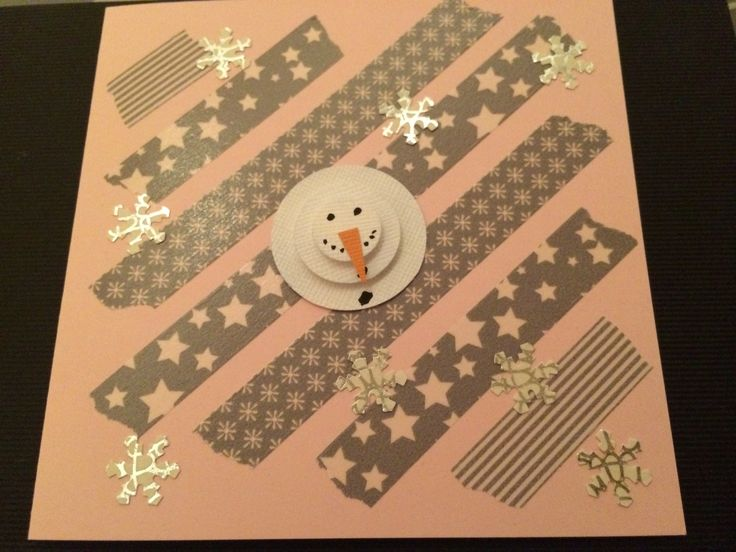 Rosa julkort och washitejp i grått från Rusta. En anögubbe gjort från tre olika cirkelstansar. Utstansade snöstjärnor från vitt och silvrigt papper. Christmas card in pink and grey. Snowman from circle punch with grey washi under.