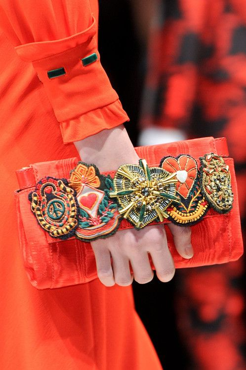 Inspiration to revamp old (vintage) clutches  using elastic and old badges, buttons, cabochons, etc.. Moschino fall 2013.