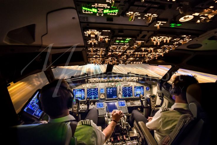 "Our ""office"", the cockpit of the Boeing 737-800 at night during our landing at Amsterdam - Schiphol."