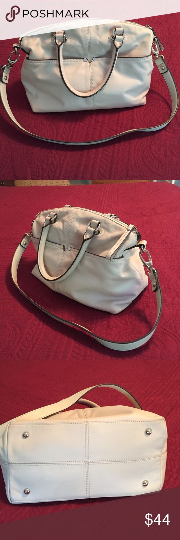 "Cream leather Tignanello handbag Tignanello ""Polished Pockets"" leather convertible satchel. Perfect condition, no spots or blemishes inside or out. Four outside slip pockets, one zip pocket and 2 more slip pockets inside. 14"" x 10"" x 6"" Tignanello Bags Satchels"