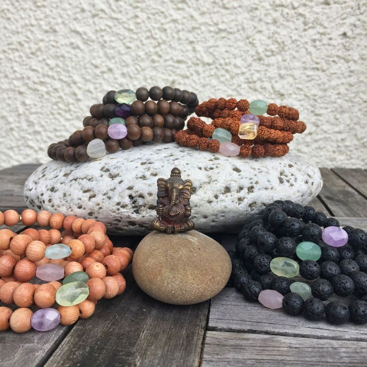 SET OF 3 MALA BRACELETS Arm Party! These mala bracelets are stretchy and come in 4 bases; rosewood, graywood, lava, rudraksha and several different gemstones; Moonstone, Prenhite, Amethyst, Aquamarine, Rose Quartz.  Stones are limited edition and vary in shapes and colouring.  http://www.karmaladesigns.bigcartel.com/