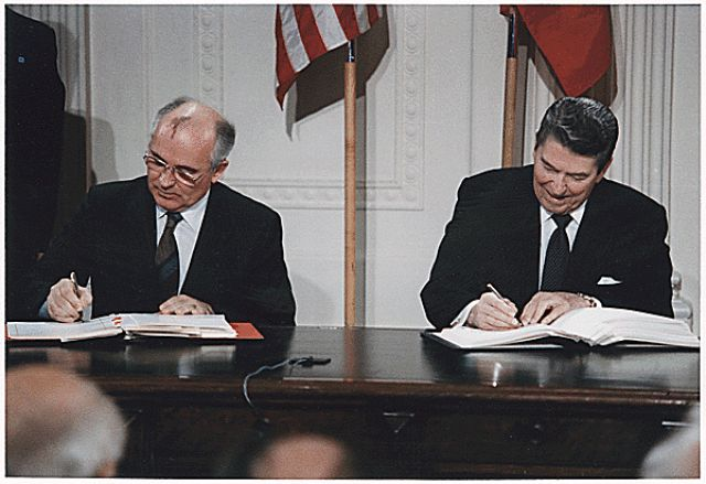 How Important Was Mikhail Gorbachev?: Picture of President Reagan and General Secretary Gorbachev signing the INF Treaty in the East Room of the White House. (December 8, 1987)