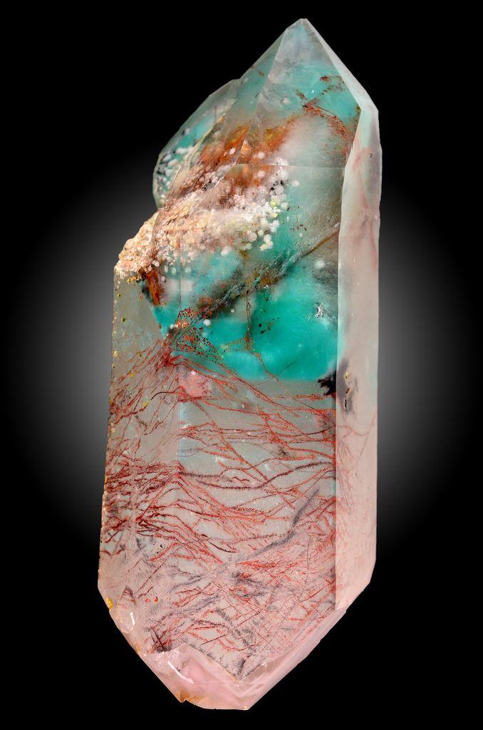 Ajoite : (K,Na)Cu7AlSi9O24(OH)6·3H2O, Kaolinite : Al2(Si2O5)(OH)4, Hematite : Fe2O3, Quartz : SiO2 ~ Artonvilla Mine, Musina, Vhembe District, Limpopo Province, South Africa  ~ Quartz included with ajoite, filamentous hematite and small spheres of kaolinite.  R. McKenzie specimen.