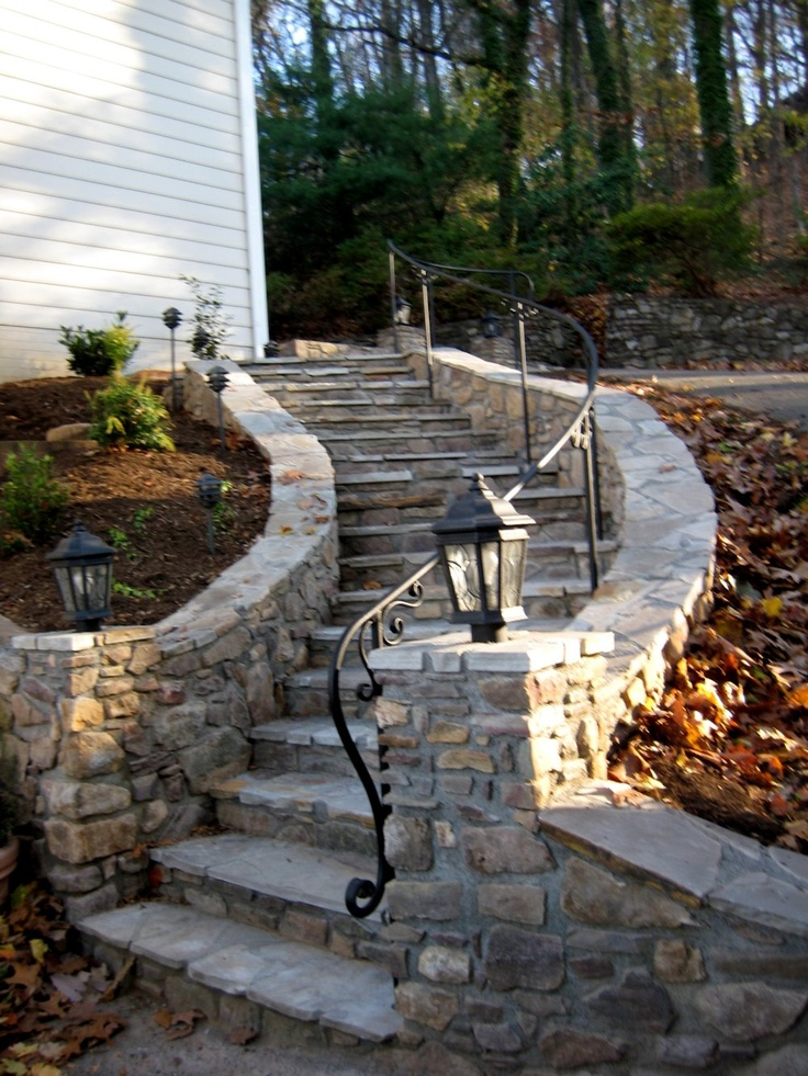 Stone steps with custom curved railing with elaborate lambs tongue in roanoke va by appalachian for Curved metal railings exterior
