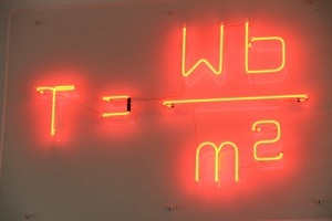 The tesla Unit of Measurement equation in neon