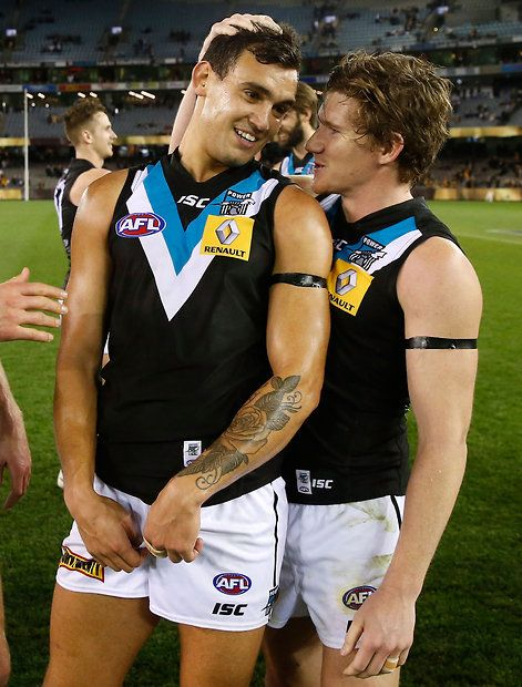 Brendon Ah Chee (Left) and Matt White (Right) of the Port Adelaide Football Club celebrate after the AFL Round 21 match between the Hawthorn Hawks and Port Adelaide Power at Etihad Stadium, Melbourne, Australia on August 21st, 2015.