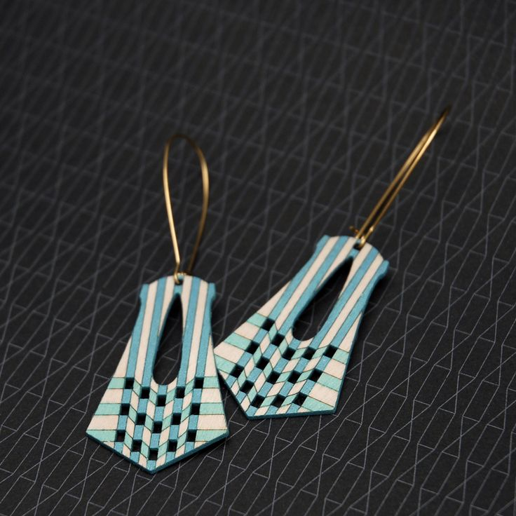 Australian made and sustainable Birch earrings, hand-painted with translucent acrylics in three duotone colours.Materials: Sustainably harvested Birch cut using green power, Raw Brass (Lead and...