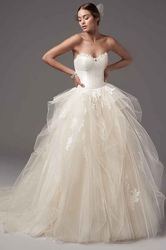Glamorous strapless tulle ballgown wedding dress; Featured Dress: Sottero and Midgley