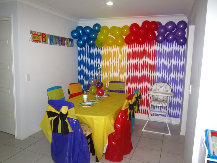 Allegra's 2nd Birthday Party - The Wiggles - I used plastic tableclolths to make the chair covers & Emma bows